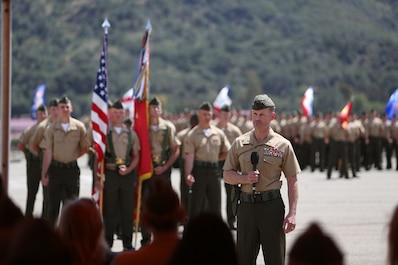 Lieutenant Col. Steven M. Sutey, newly appointed battalion commander of 1st Battalion, 1st Marine Regiment, 1st Marine Division, speaks to the Marines and loved ones of the battalion after formally receiving his command. Sutey has several past deployments with the 1st Marine Division and said he is proud to command and serve once again with the unit. (U.S. Marine Corps photo by Cpl. Carson A. Gramley/Released)
