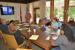 Tommy Mason, Old Hickory Resource Manager,Old Hickory Dam, talks with  Local high school teachers during an externships briefing with the U.S. Army Corps of Engineers Nashville District to develop a Science, Technology, Engineering and Mathematics class curriculum at the Old Hickory Resource Manager's Office in Hendersonville, Tenn., June 9, 2015.