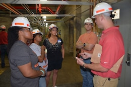 Jake Kennedy, senior electrician at the Old Hickory Power plant, and Will Garner, a hydropower engineer, talked to teachers from the Stratford Magnet High School about the powerhouse's many functions and management of the water.  The teachers spent the day using externships with the U.S. Army Corps of Engineers Nashville District to develop a Science, Technology, Engineering and Mathematics class curriculum.