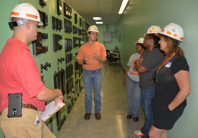 Jake Kennedy, senior electrician and Will Garner, hydropower engineer, both from the Old Hickory Power plant talks with teachers from the Stratford Magnet High School in Nashville, Tenn., July 9, 2015 about the  powerhouse's many functions and management of the water.
