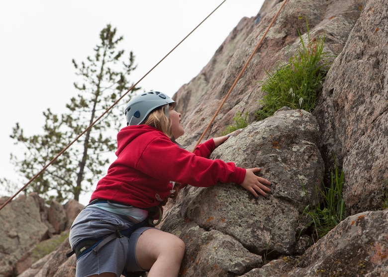 Felicity Sakura, 9, daughter of Capt. Edith Sakura, 90th Missile Wing Public Affairs, and Gary Sakura, 90th Comptroller Squadron, climbs the Beehive Buttress at the Vedauwoo Recreation Area in Medicine Bow National Forest, Wyo., June 10, 2015. The climb was one of the activities hosted by Outdoor Recreation's Basic Recreation Adventure Training Camp from F.E. Warren Air Force Base. (U.S. Air Force photo by Lan Kim)