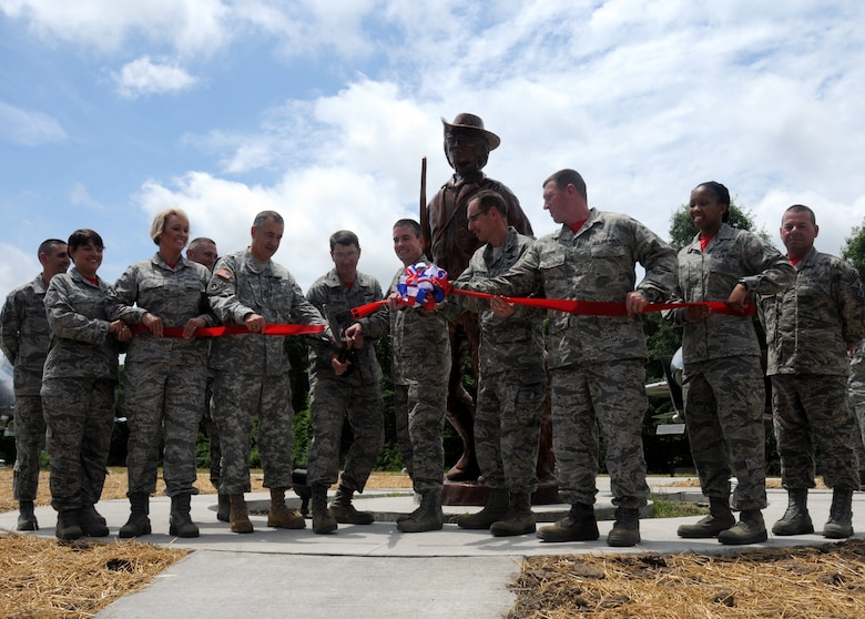 Airmen and officers of the 131st Bomb Wing and 509th Bomb Wing cut the ceremonial ribbon at the 131st Bomb Wing Heritage Park during the dedication ceremony at Whiteman Air Force Base, Missouri, June 12, 2015. Col. Michael Francis, 131st Bomb Wing commander, cut the ribbon to open the new park that hosts Whiteman's newest static aircraft, along with Missouri Adjutant General Maj. Gen. Steve Danner, 509th Bomb Wing Commander Brig. Gen. Paul Tibbets IV, Brig. Gen. Greg Champagne, and Airmen of the 131st Bomb Wing.  (U.S. Air National Guard photo by Senior Airman Nathan Dampf)