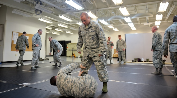 Staff Sgt. Daniel Dayton, 22nd Security Forces Squadron combatives program manager, mimics an attacker during a combatives training class June 9, 2015, at McConnell Air Force Base, Kan. Students learned different ways to defend, apprehend and create distance between themselves and a subject in real world situations. (U.S. Air Force photo by Senior Airman Colby L. Hardin)