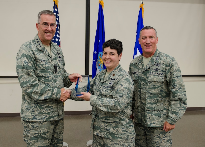Gen. John E. Hyten, Air Force Space Command commander pauses for a photo with Major Katherine V. Jones, Director of Operations at the 91st Network Warfare Squadron and Maj. Gen. B. Edwin Wilson, 24th Air Force commander during his visit to Joint Base San Antonio - Lackland, Texas, June 3. Hyten presented Jones with the Air Force Outstanding Intelligence Surveillance and Reconnaissance Field Grade Officer of the Year award. (U.S. Air Force photo by Master Sgt. Luke P. Thelen/Released)