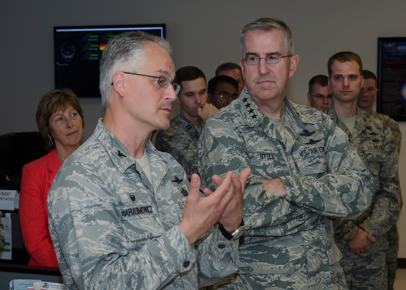 Col. Michael C. Harasimowicz (left), 688th Cyberspace Wing commander speaks to Gen. John E. Hyten, Air Force Space Command commander during his visit to Joint Base San Antonio - Lackland, Texas, June 2. Harasimowicz seized the opportunity to highlight the accomplishments of multiple personnel assigned to the 688th CW which has led to the many recent outstanding successes of the wing. (U.S. Air Force photo by Master Sgt. Luke P. Thelen/Released)