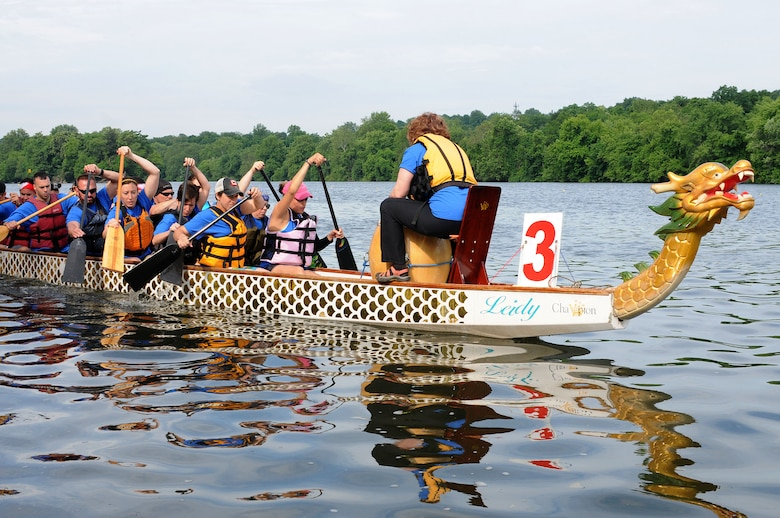 The 111th Argonauts, a dragon boat team comprised of members and affiliates of the 111th Attack Wing at Horsham Air Guard Station, paddle out to the start of the first race during the Independence Dragon Boat Regatta in Philadelphia, June 6, 2015. The team competed without a full boat for all three races. (U.S. Air National Guard photo by Tech.Sgt. Andria Allmond/Released)