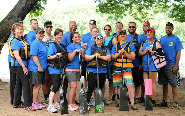 Members of the 111th Argonauts, a dragon boat team comprised of members and affiliates of the 111th Attack Wing at Horsham Air Guard Station, pose for a picture before the first race during the Independence Dragon Boat Regatta in Philadelphia, June 6, 2015. The team won three out of four races, earning the bronze medal. (U.S. Air National Guard photo by Tech.Sgt. Andria Allmond/Released)