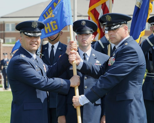 Maj. Peter Tritsch Jr., right, incoming U.S. Air Force Honor Guard commander, accepts the U.S. Air Force Honor Guard guidon from Col. Richard Lindlan, 11th Operations Group commander, during a change of command ceremony June 12, 2015, at Joint Base Anacostia-Bolling, D.C. The passing of the unit guidon during a change of command ceremony is a symbolic representation of passing authority from the outgoing commander to the incoming commander. (U.S. Air Force photo by Senior Airman Preston Webb/Released)