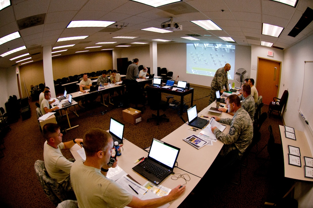 Twenty-four 167th Airlift Wing members from flightline positions attended a maintenance supervision and production mobile course at the 167th AW in Martinsburg, W.Va. June 1 – 6, 2015. The maintenance supervision production supervisor mobile course challenged the 167th AW maintenance members to test their skills from the flightline. According to Master Sgt. Dan Ritenour, the maintenance group training manager, the six day course included intense classroom instruction and two days of very realistic computer simulations of the flightline. (Air National Guard photo by Staff Sgt. Jodie Witmer/released)