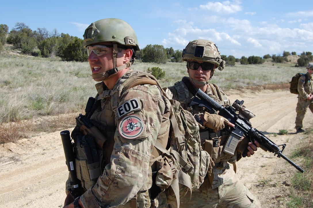 Senior Airman Darrell Linkus, explosive ordnance disposal operator, and Master Sgt. Richard Gibbons, flight chief with the 140th Explosive Ordnance Disposal Flight, 140th Wing, Colorado Air National Guard, practice security techniques during a training exercise at Airburst Range, Ft. Carson, Colo. May 12, 2015.  (Air National Guard photo by Capt. Kinder Blacke)