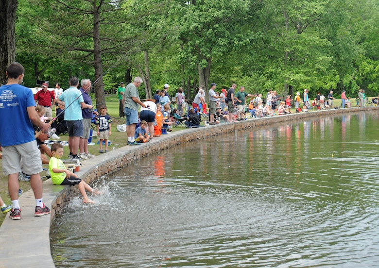 Hundreds of area residents are elbow-to-elbow lining the freshly stocked pond at Kohler Park June 6, 2015, Horsham, Pennsylvania. The pond was stocked for the township's annual Horsam Day celebration. (U.S. Air National Guard photo by Staff Sgt. Michael Shaffer/released)