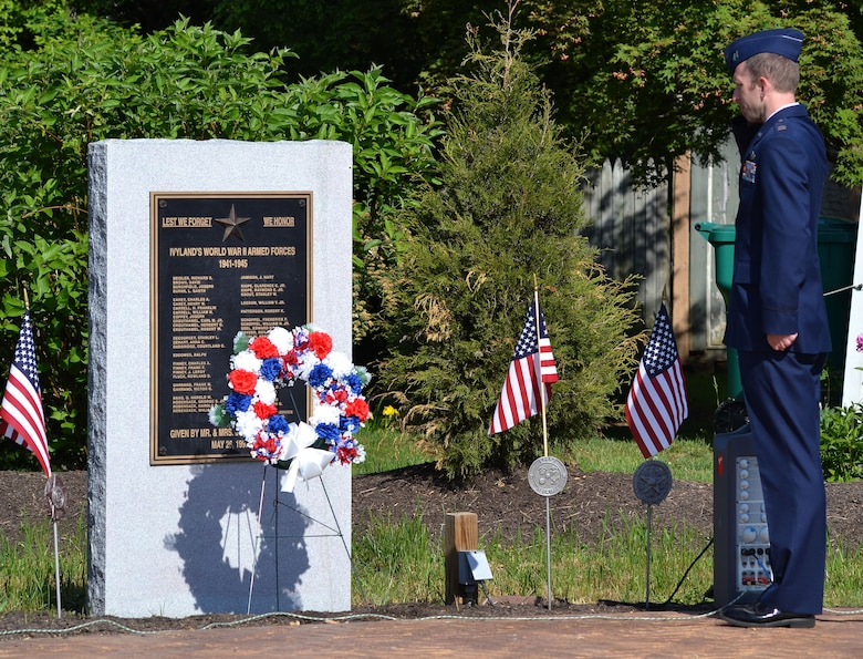 "During a wreath laying ceremony in Ivyland, Pennsylvania, May 25, 2015, Capt. Timothy McManus, wing executive officer with the 111th Attack Wing at Horsham Air Guard Station, renders a salute to resident veterans of World War II as ""Taps"" is played in the background. (U.S. Air National Guard photo by Master Sgt. Christopher Botzum/Released)"