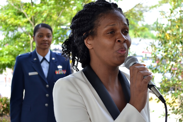 Opening the Valley Forge Casino's 2015 Armed Forces Day recognition event, May 16, 2015, Tasha Moore, banquet captain with the casino, belts an a cappella rendition of the national anthem. First Lt. Charese Adams, logistic readiness office with the 201st RED HORSE, Detachment 1, was this year's keynote speaker during the ceremony. (U.S. Air National Guard photo by Master Sgt. Christopher Botzum/Released)