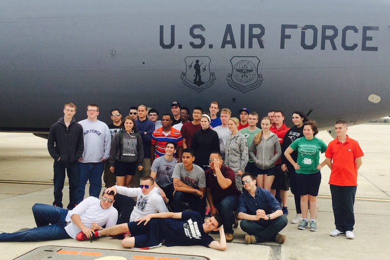Cadets from the Torrington Naval Junior Reserve Officers' Training Corps program in Connecticut pose for a photo beside a KC-135 aircraft during a two-day hands-on tour here as part of an annual field trip last month. The group of nearly 40 cadets visited and received briefings from members of the Fire Department, 157th Security Forces Squadron, Aircraft Maintenance and Emergency Management. The cadets were also able to participate in a mission on board a KC-135 and an air refueling. (N.H. National Guard photo by Senior Airman Kayla McWalter)