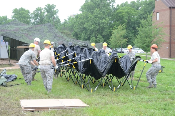 Citizen-Airmen of the 131st Bomb Wing train for state emergency response by setting up a tent shelter at Whiteman Air Force Base, Missouri, June 6, 2015.  Since 2009, the Missouri National Guard has mobilized almost 6,000 Citizen-Airmen and Citizen-Soldiers for 15 state missions.