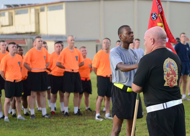 Lt. Col. Jefferey Slown, Task Force Talon commander, speaks to Soldiers and Airmen after a 3-mile esprit de corps run June 12, 2015, at Andersen Air Force Base, Guam.  The event was held in honor of the Army's 240th Birthday. (U.S. Air Force photo by Airman 1st Class Alexa Ann Henderson/Released)