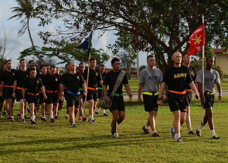 Soldiers from Task Force Talon march after an esprit de corps run June 12, 2015, at Andersen Air Force Base, Guam.  The event was held in honor of the Army's 240th Birthday. (U.S. Air Force photo by Airman 1st Class Alexa Ann Henderson/Released)