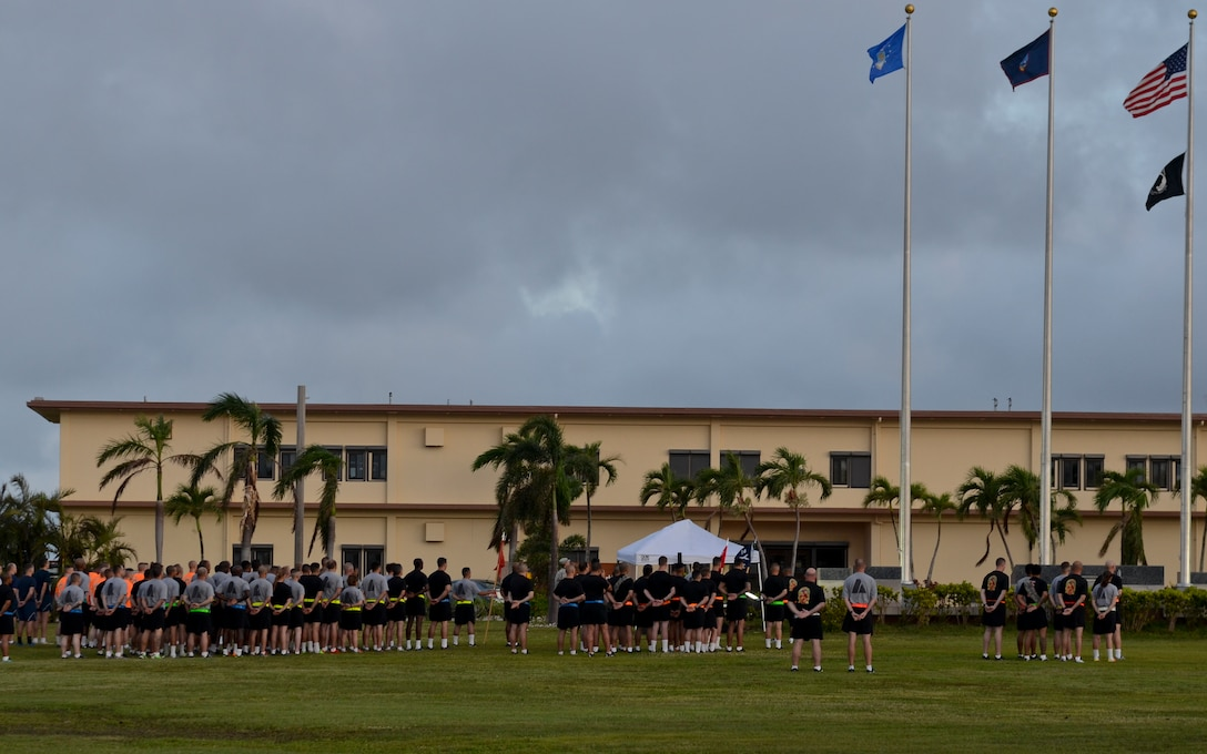 Soldiers from Task Force Talon stand in formation before they start their 3-mile esprit de corps run June 12, 2015, at Andersen Air Force Base, Guam.  The event was held in honor of the Army's 240th Birthday. (U.S. Air Force photo by Airman 1st Class Alexa Ann Henderson/Released)