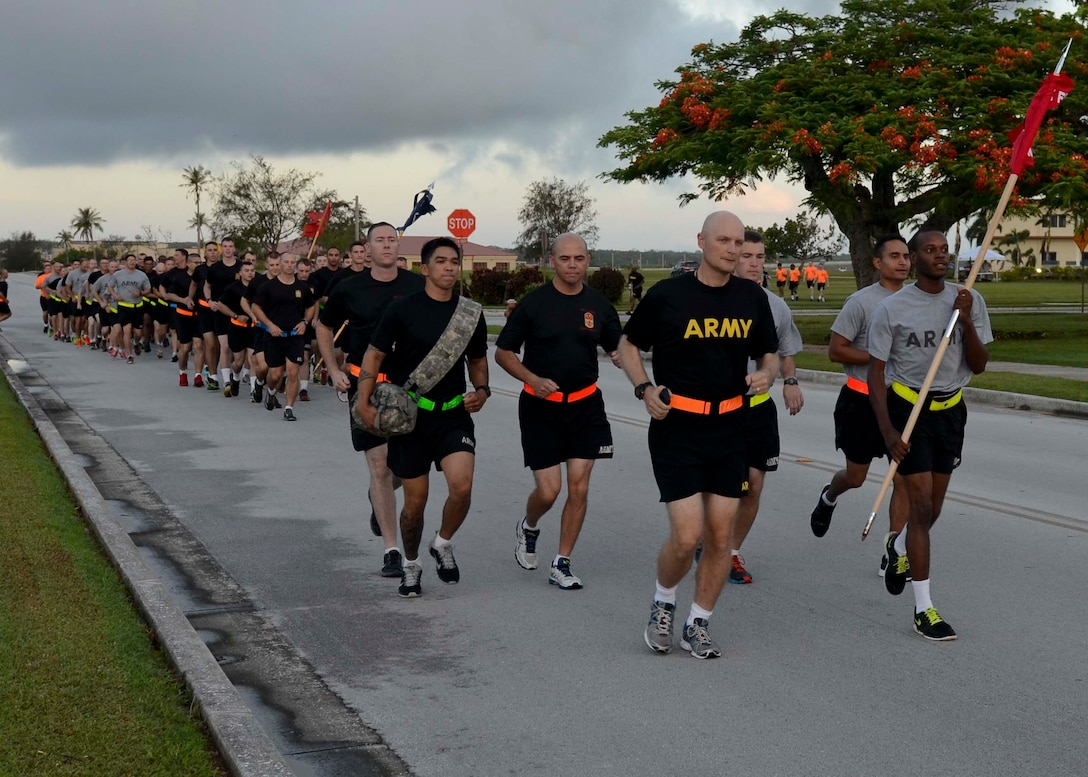 Soldiers from Task Force Talon participate in an esprit de corps run June 12, 2015, at Andersen Air Force Base, Guam.  The event was held in honor of the Army's 240th Birthday. (U.S. Air Force photo by Airman 1st Class Alexa Ann Henderson/Released)