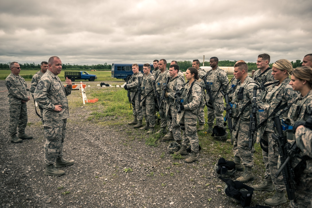 """Chief Master Sgt. James W. Hotaling, Command Chief Master Sergeant of the Air National Guard, addresses members of the 107th AW Security Forces after participating in a """"shoot and move"""" exercise in response to a Chief's Challenge at Niagara Falls Air Reserve Station on June 13, 2015. (U.S. Air National Guard photo/Staff Sgt. Ryan Campbell)"""