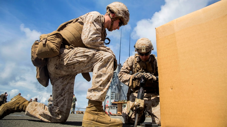 U.S. Marine Lance Cpl. Trent Martin, left, instructs Lance Cpl. Zachary Thompson during immediate-action drills aboard USS Rushmore at sea in the Pacific Ocean, June 1, 2015. Martin and Thompson are automatic riflemen with Kilo Company, Battalion Landing Team 3rd Battalion, 1st Marine Regiment, 15th Marine Expeditionary Unit. BLT 3/1 constantly trains for the unknown in order to respond to the needs of the MEU while deployed. These drills keep the Marines in a constant state of combat readiness while at sea.