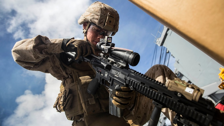 U.S. Marine Lance Cpl. Jose Garcia practices immediate-action drills aboard USS Rushmore at sea in the Pacific Ocean, June 1, 2015. Garcia is a rifleman with Kilo Company, Battalion Landing Team 3rd Battalion, 1st Marine Regiment, 15th Marine Expeditionary Unit. BLT 3/1 constantly trains for the unknown in order to respond to the needs of the MEU while deployed. These drills keep the Marines in a constant state of combat readiness while at sea.
