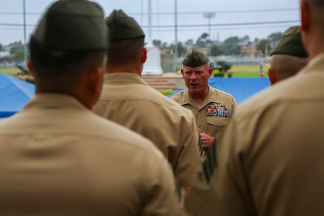 Major General Lawrence D. Nicholson, the commanding general of the 1st Marine Division, congratulates Marines chosen from the division to attend the new Squad Leader Development Program, aboard Marine Corps Base Camp Pendleton, Calif., June 12, 2015. The program will allow qualified Marines to develop a career path as an infantry squad leader.