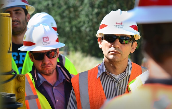 Adalberto Meller, left, and Josimar Oliveira, engineers with Agência Nacional de Águas, Brazil, visit a Corps construction site in Sacramento, California, June 3, 2015.