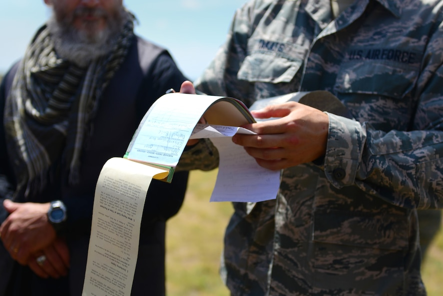 U.S. Air Force Airman 1st Class John Takats, 27th Special Operations Contracting Squadron, looks over a receipt during an exercise June 9, 2015 at Melrose Air Force Range, N.M. During the exercise, finance and contracting Air Commandos received financial training and practiced managing contracts and contract personnel in a contingency environment.  (U.S. Air Force photo/Senior Airman Eboni Reece)