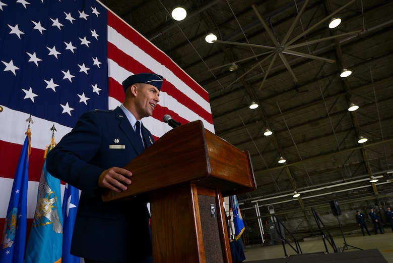 Col. Brook Leonard, outgoing 51st Fighter Wing commander, speaks to the audience at the 51st FW change of command ceremony June 16, 2015, at Osan Air Base, Republic of Korea. Leonard reflected on his two-year tour at Osan, and said teamwork is the only way for Airmen in the U.S. and ROK to continue to improve. (U.S. Air Force photo by Staff Sgt. Jake Barreiro/Released)