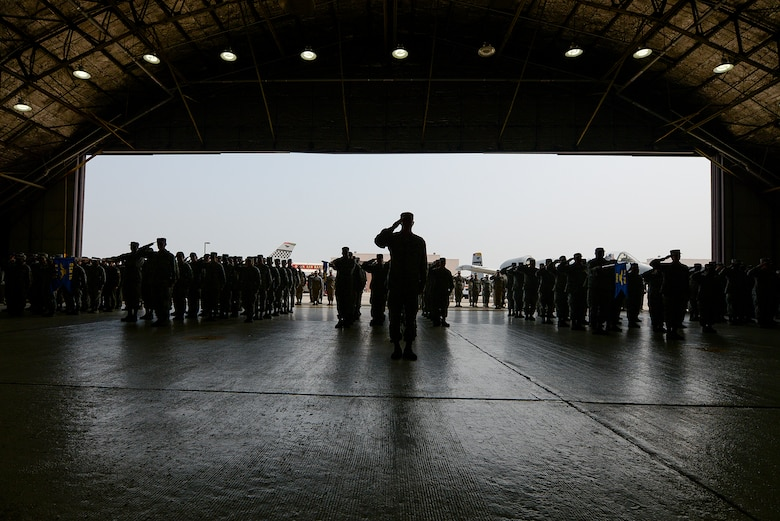 The 51st Fighter Wing stands in formation at the 51st FW change of command ceremony June 16, 2015, at Osan Air Base, Republic of Korea. The event signified the transfer of authority in the 66-year-old fighter wing. (U.S. Air Force photo by Staff Sgt. Jake Barreiro/Released)