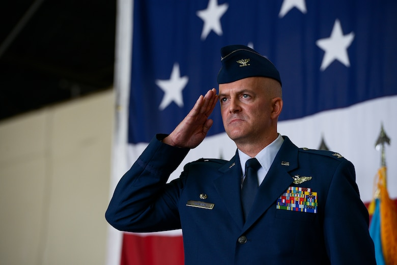 Col. Andrew Hansen, incoming 51st Fighter Wing commander, salutes the formation during the 51st FW change of command ceremony June 16, 2015, at Osan Air Base, Republic of Korea. Hansen is the 63rd commander in the wing's history. (U.S. Air Force photo by Staff Sgt. Jake Barreiro/Released)