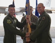 Lt. Col. Dennis Cummings assumes command of the 20th Bomb Squadron from Col. Douglas Gosney, 2nd Operations Group commander, during a change of command ceremony on Barksdale Air Force Base, La., June 12, 2015. The change of command ceremony is a military tradition that represents a formal transfer of authority and responsibility of a unit from one commanding officer to another. The 20th BS, which has served in every major global conflict with the exception of the Korean War, has a history dating back to 1917. (U.S. Air Force photo/Airman 1st Class Curt Beach)