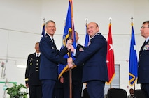 Mississippi Air National Commander, Maj. Gen William O. Hill (left) is shown presenting the 172d Airlift Wing flag to new wing commander, Col. Barry A. Blanchard (center).  Former 172d AW commander, Jonathan T. Wall (right) relinquished command of the Wing on June 7, 2015.