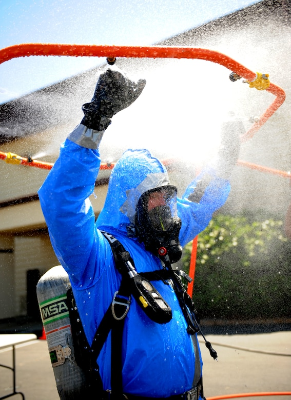 Airman 1st Class Robert Rybicky, 9th Aerospace Medicine Squadron bioenvironmental technician, begins decontamination as part of an exercise on June 11, 2015 at Beale Air Force Base, California. The exercise was part of the Integrated Base Emergency Response Capabilities Training designed to strengthen Airmen's emergency response skills. (U.S. Air Force photo by Airman Preston L. Cherry/Released)