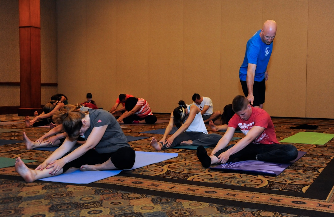Airmen and family members take part in a yoga class, one of the many breakout sessions that members could choose to participate in during the three day Yellow Ribbon event weekend, May 29-31, Sunriver Resort, Bend, Ore. (U.S. Air National Guard photo by Tech. Sgt. John Hughel, 142nd Fighter Wing Public Affairs /Released)