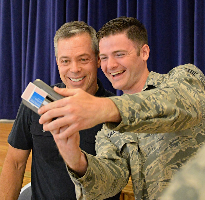"Comedian Bernie McGrenahan takes a photo with a Beale Airman after his performance, ""Comedy with a Message,"" June 12, 2015, at Beale Air Force Base, California. McGrenahan began his comedy tour in 1995 to promote resiliency, safety, bystander intervention and respect. He also shares his experiences overcoming addiction. (U.S. Air Force photo by Airman 1st Class Ramon A. Adelan/Released)"
