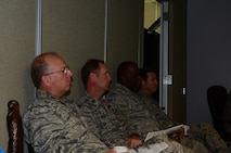 172d Airlift Wing Commanders participate in the production meeting daily, ensuring they know the most accurate aircraft data and can apply resources where needed.  Above seated from left to right are commanders within the group: Col. Lynn Cole, Maj. Dale Shepherd, Lt. Col. Tyrone Williams and Lt. Col. Wyatt Rives.