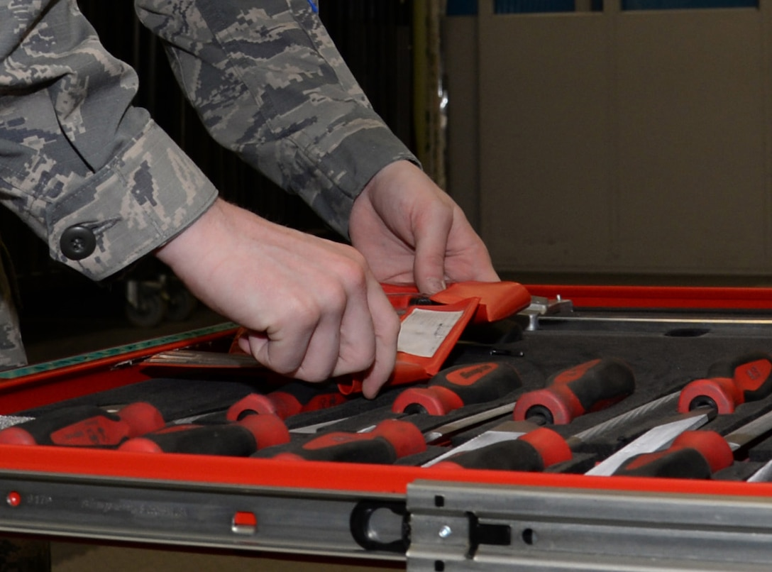 U.S. Air Force Airman 1st Class Donavan Jerles, 100th Maintenance Squadron Aircraft Structural apprentice from Gulf Shores, Ala., selects tools to work on a honeycomb core while preparing the material for fiberglass repair June 3, 2015, on RAF Mildenhall, England. The honeycomb core is used to distribute the load stress across of the entirety of the panel. When an aircraft receives damage to skins (outside metal) the section personnel remove damage and repair it by adding more material. (U.S. Air Force photo by Gina Randall/Released)