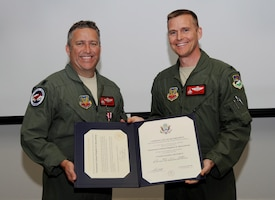 The 142nd Fighter Wing commander Col. Rick Wedan presents the Certificate of Retirement to Lt. Col. Steve Beauchamp during his retirement ceremony in Portland, Oregon, in 2013. A new military retirement proposal has been presented to Congress.
