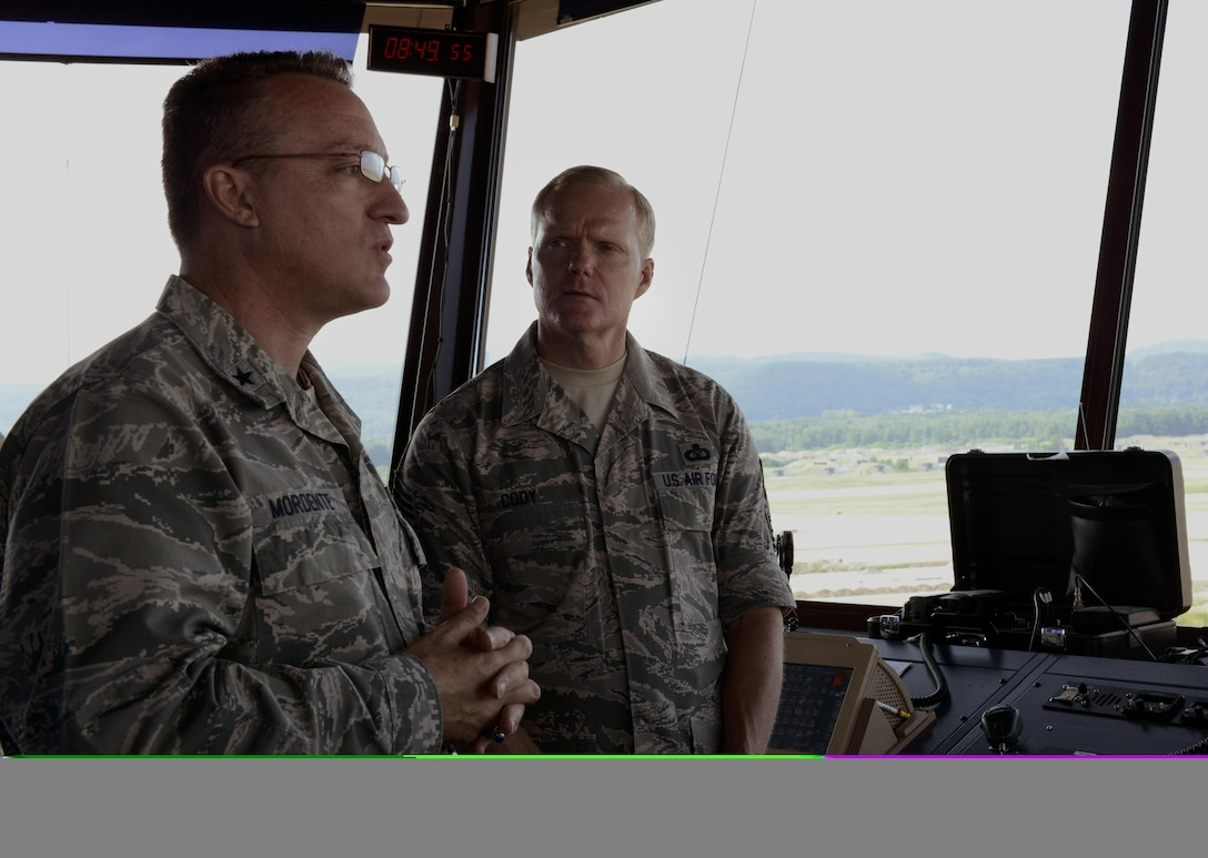 Brig. Gen. Patrick X. Mordente, the 86th Airlift Wing commander, demonstrates to Chief Master Sgt. of the Air Force James A. Cody the different aspects of Ramstein Air Base, Germany, from the control tower June 15, 2015. An all call with Cody was held during his visit to give Airmen an opportunity to ask him questions they had about Air Force policies directly. (U.S. Air Force photo/Airman 1st Class Tryphena Mayhugh)