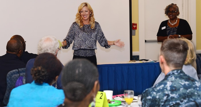 """Military Child Education Coalition professional development trainer, Jenny Cogbill, introduces herself to more than 40 Albany, Georgia, area educators, public school administrators, social workers as well as other base and local professionals on """"The Journey from 'Welcome Home' to Now: Reunion, Reconnecting, Routine."""" The daylong event was held at the base's Major S.P. """"Swede"""" Hansen Officers' Lounge, June 16."""