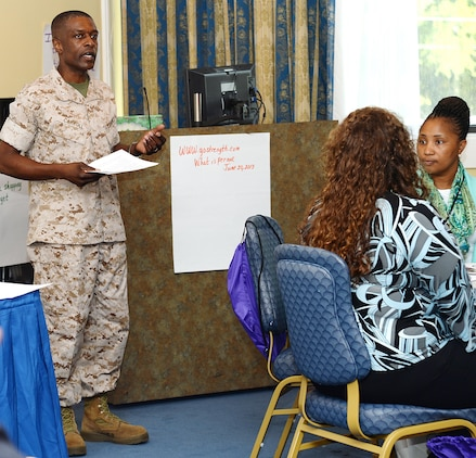 """Lt. Col. James C. Carroll III, commanding officer, Marine Corps Logistics Base Albany, welcomes more than 40 Albany, Georgia, area educators, public school administrators, social workers as well as other base and local professionals to the training entitled, """"The Journey from 'Welcome Home' to Now: Reunion, Reconnecting, Routine."""" The daylong event was held at the base's Major S.P. """"Swede"""" Hansen Officers' Lounge, June 16."""