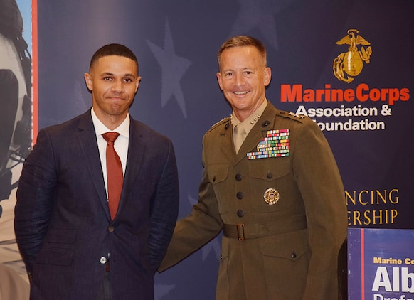 Sgt. Josue Balbuena, enlisted barracks manager and unit energy manager, Marine Corps Logistics Base Albany, poses with Lt. Gen. William Faulkner, deputy commandant, Installations and Logistics, at a Marine Corps Association and Foundation hosted dinner at the Hilton Garden Inn, Albany, Georgia, recently.