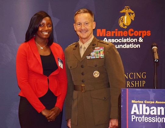 Sgt. Artisha Burnett, supply chief and Single Marine Program President, Marine Corps Logistics Command, poses with Lt. Gen. William Faulkner, deputy commandant, Installations and Logistics, at a Marine Corps Association and Foundation hosted dinner at the Hilton Garden Inn, Albany, Georgia, recently.