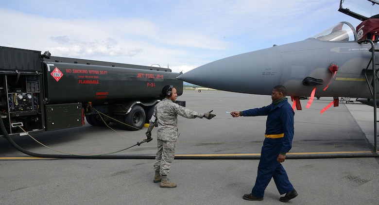 Airman 1st Class Deniqwia Brooks, a 673rd Logistics Readiness Squadron fuels specialist, prepares to fuel an F-15C Eagle on the flightline at Joint Base Elmendorf-Richardson, Alaska, June 8, 2015. The fuels management flight was recently recognized as the best in the Air Force due to its stellar performance despite the fact that they operate out of three geographically distant areas on an installation larger than all other Pacific Air Forces bases combine. (U.S. Air Force photo/Staff Sgt. Wes Wright)