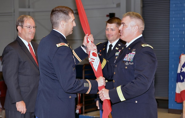 (second from left) Lt. Col. Stephen F. Murphy, incoming commander, receives the unit colors from Brig. Gen. Richard G. Kaiser, U.S. Army Corps of Engineers Great Lakes and Ohio River Division commander, during the change of command ceremony at the Tennessee National Guard Armory in Nashville, Tenn. June 16, 2015.  Looking on is Nashville District Deputy District Engineer for Program Management Mike Wilson, (far left) and outgoing commander, Lt. Col. John L. Hudson. (center)