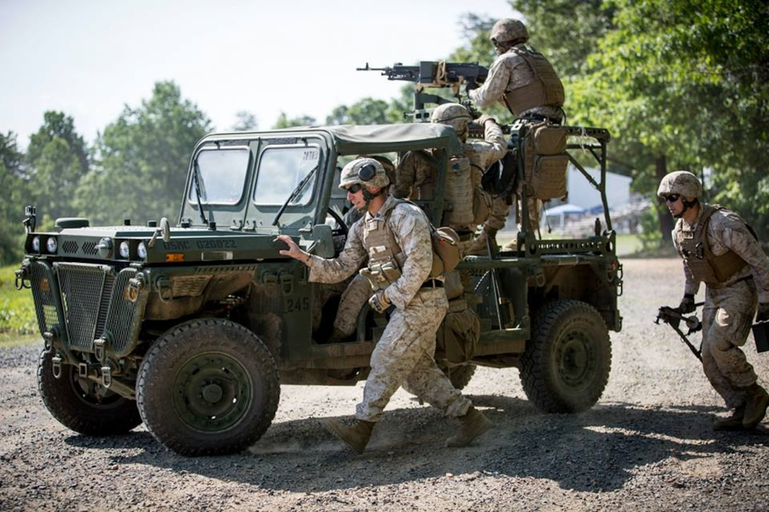 Marines from The Basic School (TBS) participate in determining the effectiveness of unloading and loading munitions from the M1161 Growler Internally Transportable Vehicle (ITV).