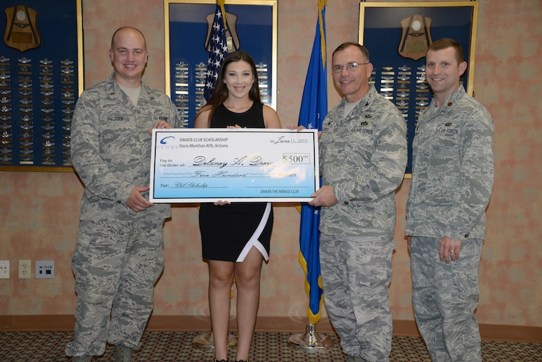 Delaney Alyssa Drew receives a check for $500 from the Air Force Clubs Scholarship Program by 2nd Lt. Charles Hulsizer, 355th Force Support Squadron career development chief, Col. Rodger Schuld, 355th Mission Support Squadron commander, and Maj. Stephen Anderson, 355th Force Support Squadron commander.  (Courtesy photo)
