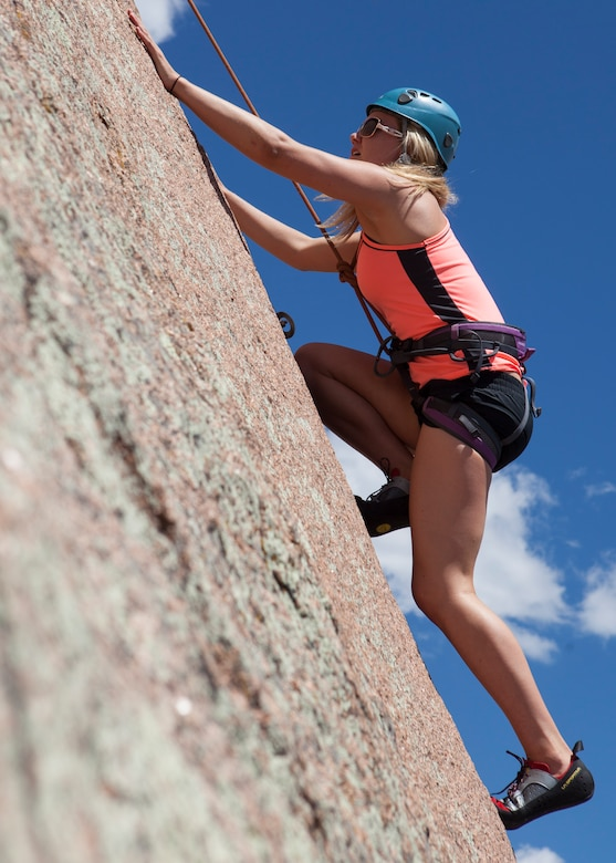 Rachel Bower, 90th Force Support Squadron Aquatics Center lifeguard recreation assistant, climbs the Fall Wall in the Vedauwoo Recreation Area of Medicine Bow National Forest, June 14, 2015. Bower was part of a rock climbing trip hosted by F.E. Warren Air Force Base's Outdoor Recreation. (U.S. Air Force photo by Lan Kim)